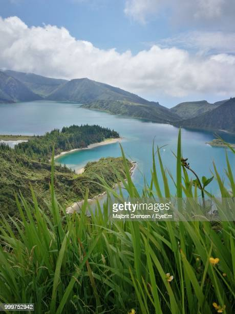scenic view of lake against sky - ponta delgada stock photos and pictures