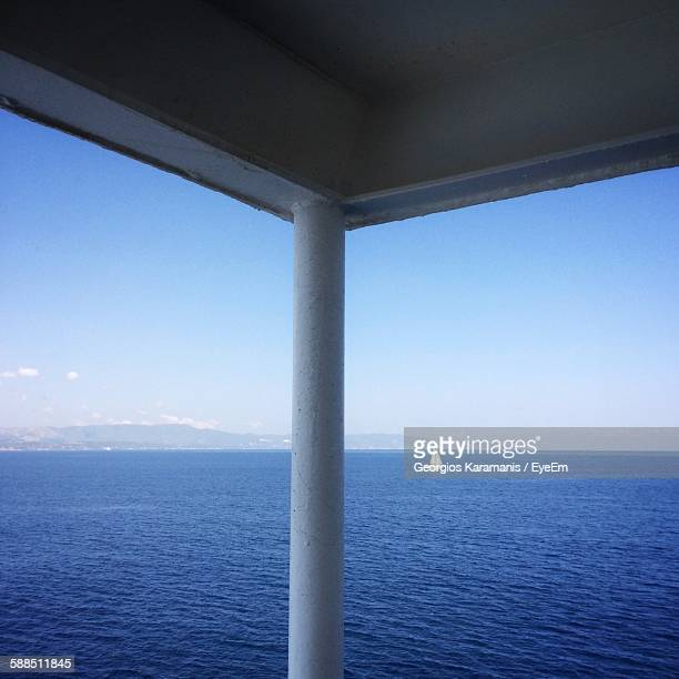 Scenic View Of Lake Against Sky Seen Through Window