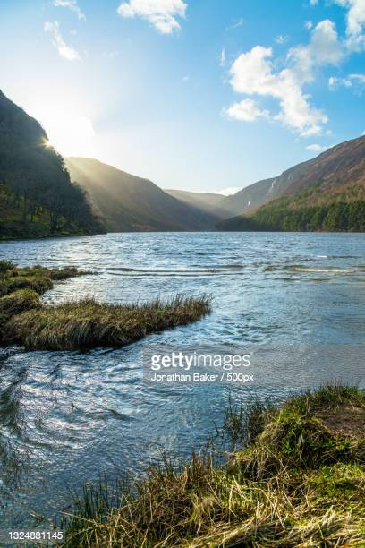 scenic view of lake against sky,glendalough upper lake,ireland - nature stock pictures, royalty-free photos & images