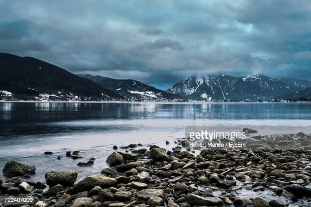 Scenic View Of Lake Against Storm Clouds