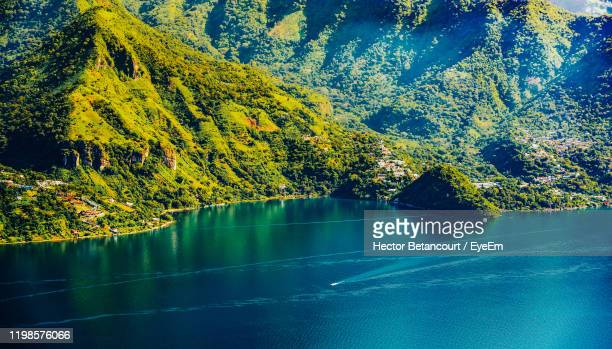 scenic view of lake against trees - guatemala city stock pictures, royalty-free photos & images