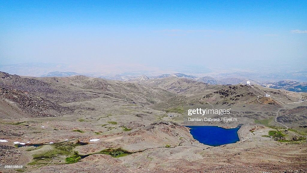 Scenic View Of Lake Amidst Mountains Against Sky : Stock Photo