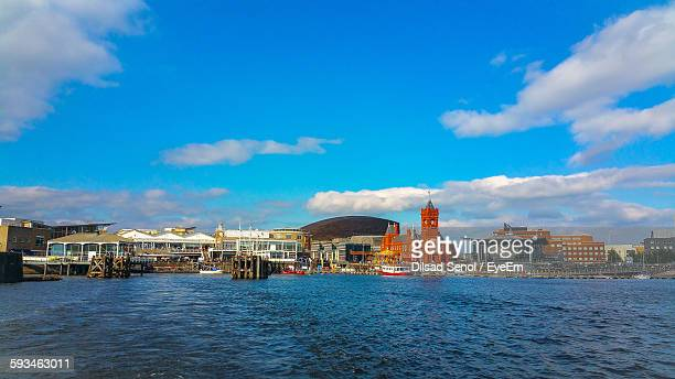 scenic view of lake and buildings against sky - cardiff stock pictures, royalty-free photos & images