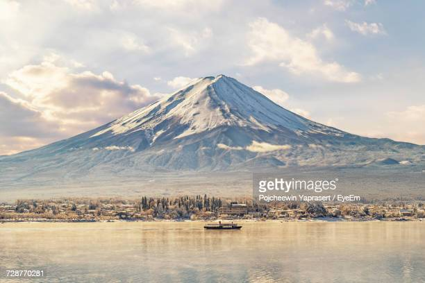 scenic view of lake and mount fuji against sky - mount fuji stock photos and pictures