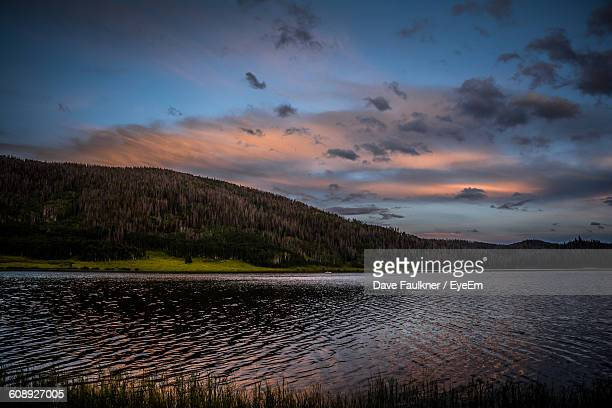Scenic View Of Lake And Mountain Against Sky During Sunset