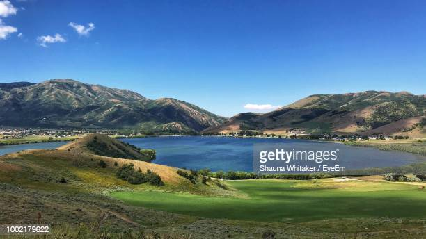 scenic view of lake and mountains against blue sky - mantua stock pictures, royalty-free photos & images