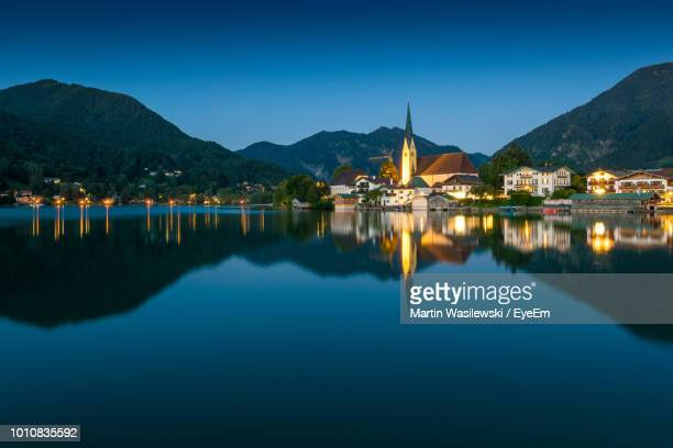 scenic view of lake and mountains against blue sky - tegernsee stock pictures, royalty-free photos & images