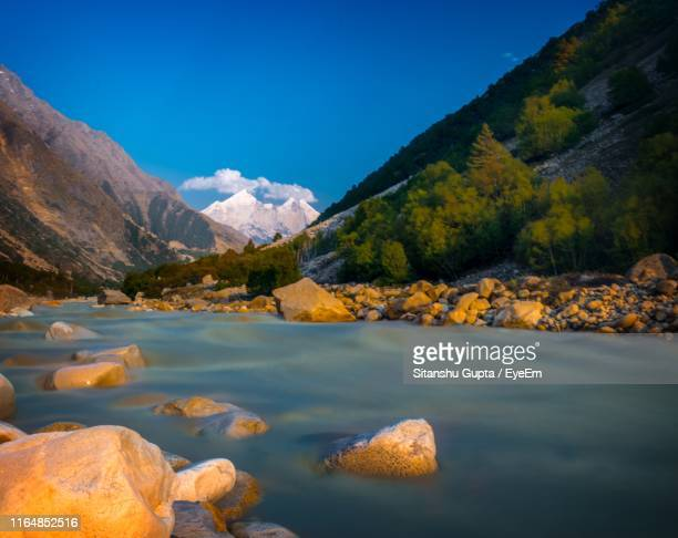 scenic view of lake and mountains against blue sky - river ganges stock pictures, royalty-free photos & images
