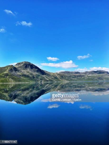 scenic view of lake and mountains against blue sky - eriksen stock pictures, royalty-free photos & images