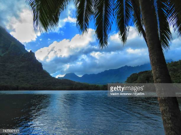 scenic view of lake and mountains against blue sky - antonov stock pictures, royalty-free photos & images