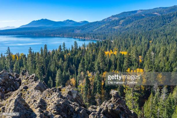 scenic view of lake and mountains against blue sky - lake tahoe stock photos and pictures
