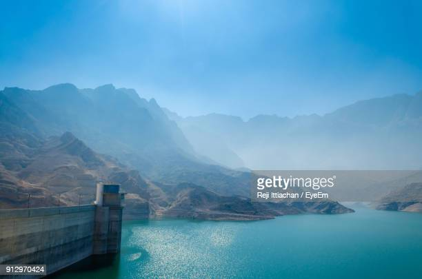 scenic view of lake and mountains against blue sky - oman stock pictures, royalty-free photos & images