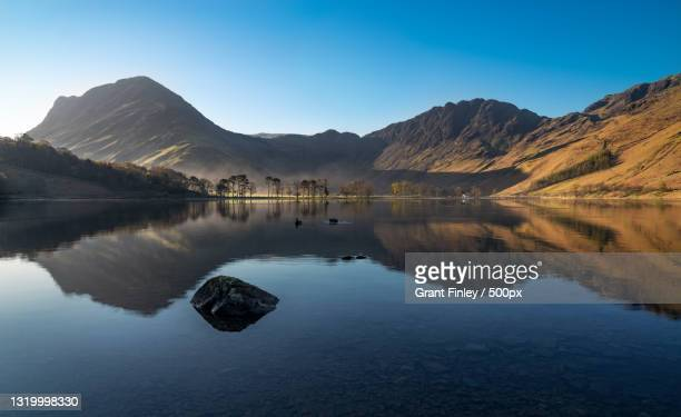 scenic view of lake and mountains against clear blue sky,cockermouth,united kingdom,uk - remote location stock pictures, royalty-free photos & images