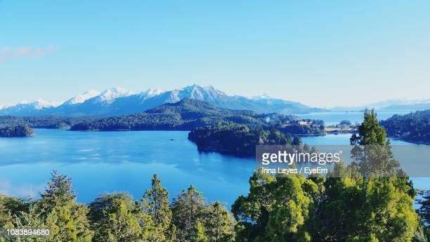 scenic view of lake and mountains against clear blue sky - bariloche stock pictures, royalty-free photos & images