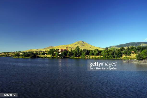 scenic view of lake and mountains against clear blue sky - segovia stock pictures, royalty-free photos & images