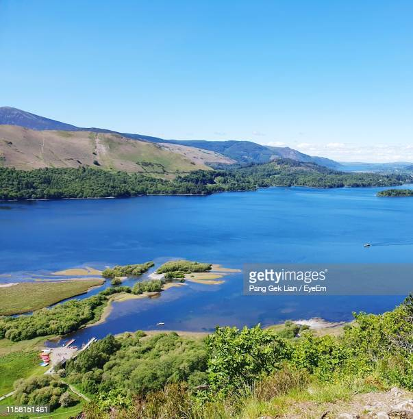 scenic view of lake and mountains against clear blue sky - keswick stock pictures, royalty-free photos & images