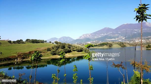 scenic view of lake and mountains against clear blue sky - tirana stockfoto's en -beelden
