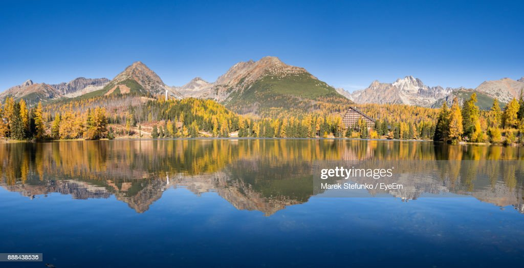 Scenic View Of Lake And Mountains Against Clear Blue Sky : Stock Photo