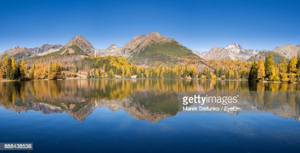 scenic view of lake and mountains against clear blue sky - marek stefunko stockfoto's en -beelden
