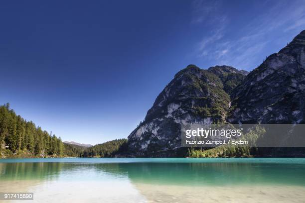 scenic view of lake and mountains against clear blue sky - fabrizio zampetti foto e immagini stock