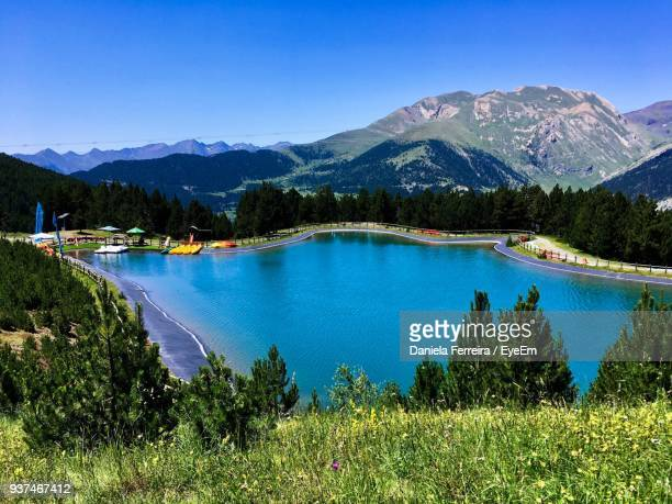 scenic view of lake and mountains against clear blue sky - andorra stock pictures, royalty-free photos & images