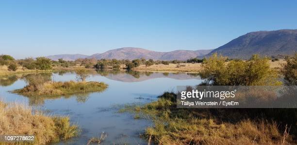 scenic view of lake and mountains against clear sky - weinstein stock pictures, royalty-free photos & images