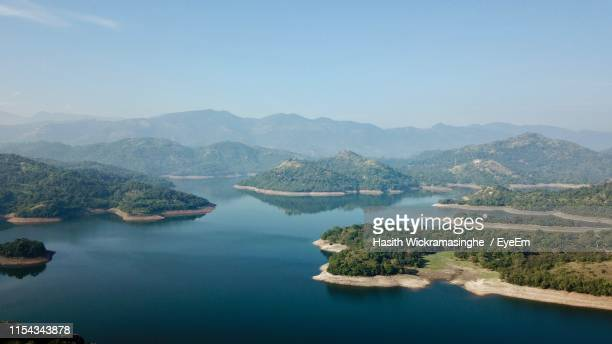 scenic view of lake and mountains against clear sky - kandy kandy district sri lanka stock pictures, royalty-free photos & images