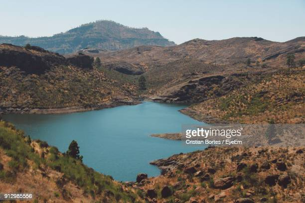 scenic view of lake and mountains against clear sky - bortes cristian stock photos and pictures