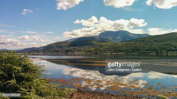 scenic view of lake and mountains against sky - grampian scotland stock pictures, royalty-free photos & images