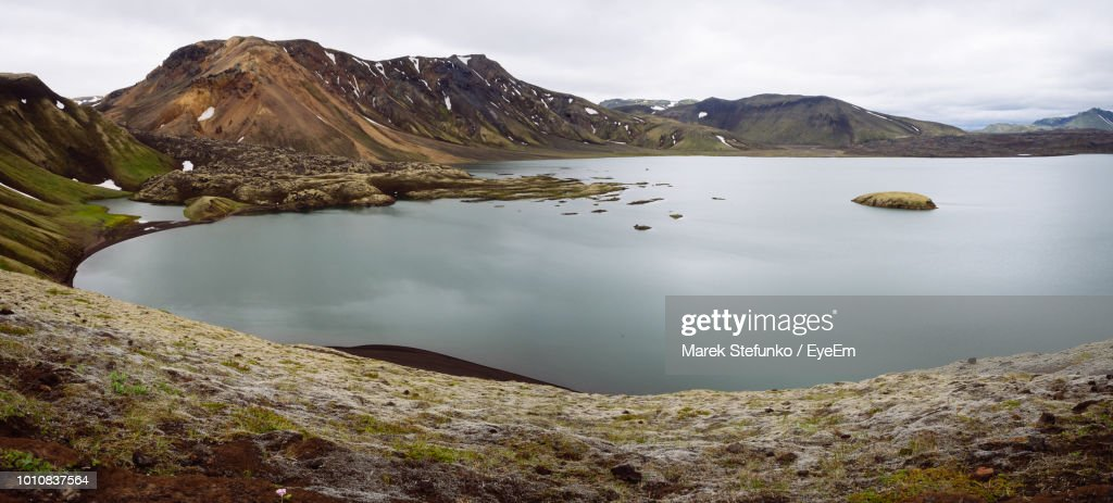 Scenic View Of Lake And Mountains Against Sky : Stock Photo