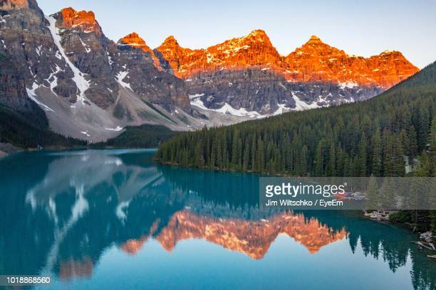 scenic view of lake and mountains against sky - lake louise lake stock photos and pictures