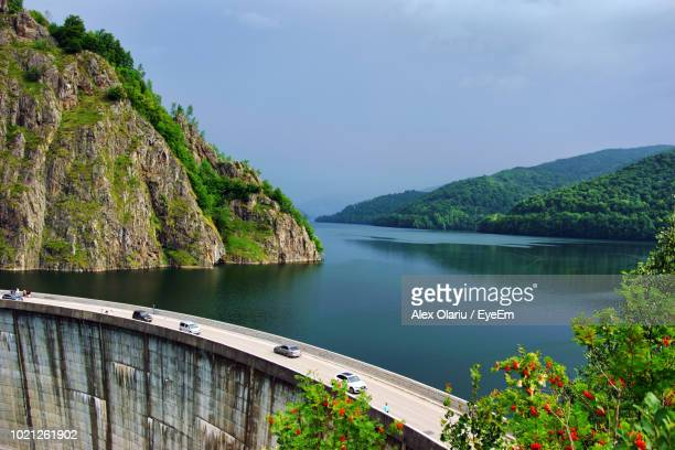scenic view of lake and mountains against sky - alex olariu stock photos and pictures