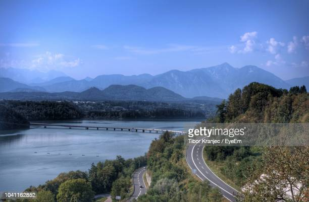 scenic view of lake and mountains against sky - 静かな情景 ストックフォトと画像