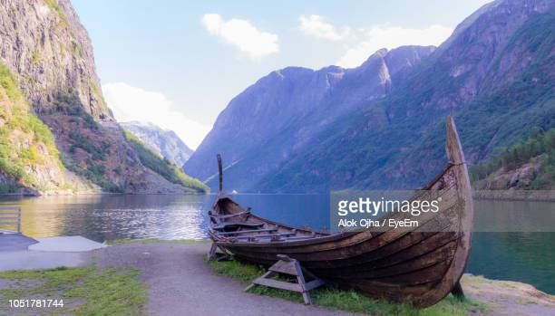 scenic view of lake and mountains against sky - viking stock photos and pictures