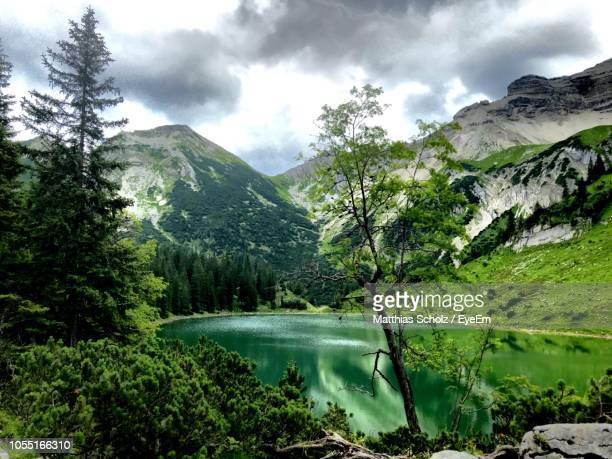 scenic view of lake and mountains against sky - krün stock-fotos und bilder