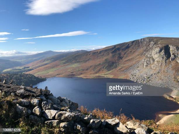 scenic view of lake and mountains against sky - amanda and amanda stock pictures, royalty-free photos & images