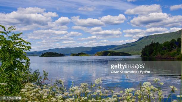 scenic view of lake and mountains against sky - hordaland county stock pictures, royalty-free photos & images