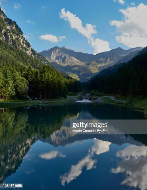 scenic view of lake and mountains against sky - liechtenstein stock pictures, royalty-free photos & images