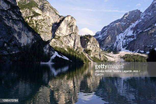 scenic view of lake and mountains against sky - lagarde stock photos and pictures
