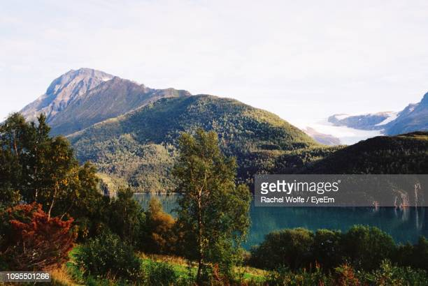 scenic view of lake and mountains against sky - rachel wolfe stock pictures, royalty-free photos & images