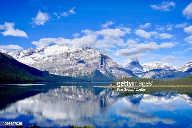 scenic view of lake and mountains against sky - kananaskis country stock pictures, royalty-free photos & images