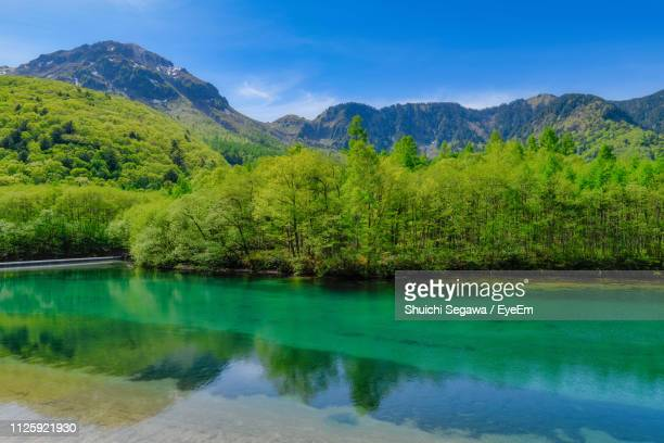 scenic view of lake and mountains against sky - 長野県 ストックフォトと画像
