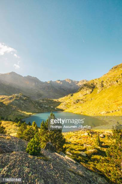 scenic view of lake and mountains against sky - andorra stock pictures, royalty-free photos & images