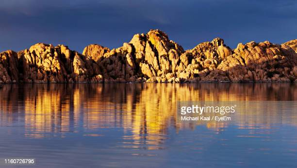 scenic view of lake and mountains against sky - kaal stock pictures, royalty-free photos & images