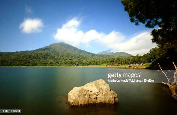 scenic view of lake and mountains against sky - made widhana stock photos and pictures