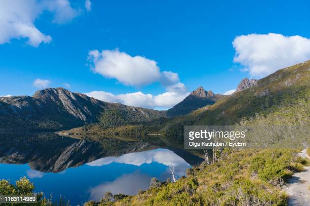 scenic view of lake and mountains against sky - tasmania stock pictures, royalty-free photos & images