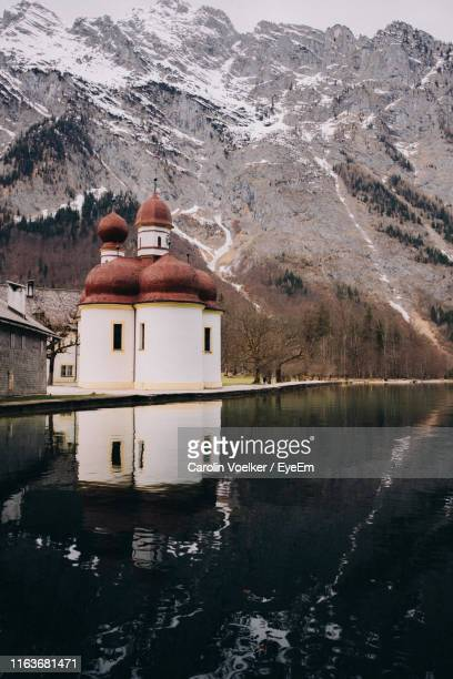 scenic view of lake and mountains against sky - königssee bavaria stock photos and pictures