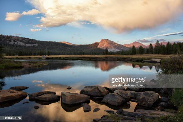 scenic view of lake and mountains against sky - jennifer mellone foto e immagini stock