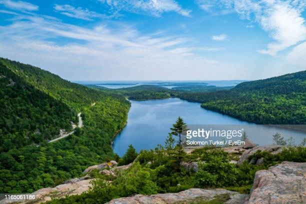 scenic view of lake and mountains against sky - solomon turkel stock pictures, royalty-free photos & images
