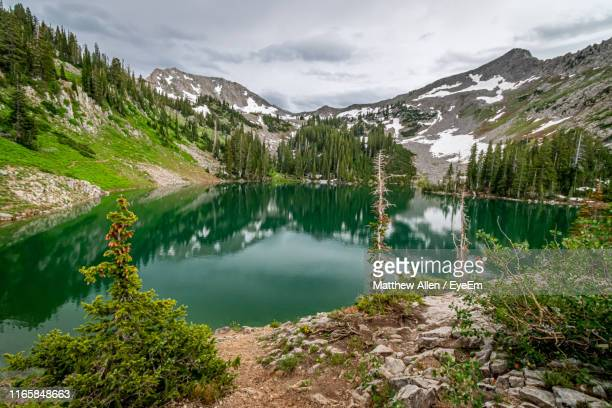 scenic view of lake and mountains against sky - utah stock pictures, royalty-free photos & images